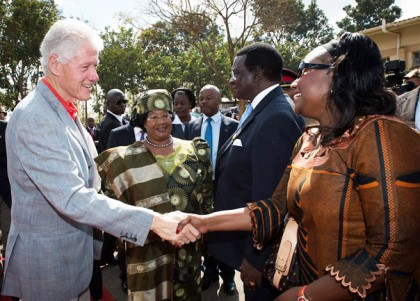 President Bill Clinton and Malawian President Joyce Banda greet people outside of Kamuzu Central Hospital in Lilongwe, Malawi